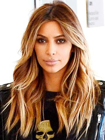 Kim Kardashian says the couple want to wed abroad